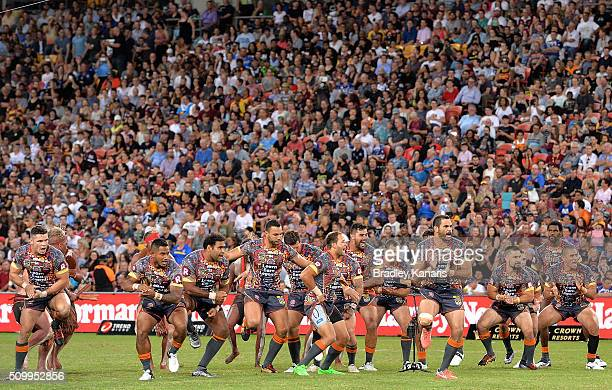 Greg Inglis of the Indigenous All Stars leads his team into an indigenous cultural war dance before the NRL match between the Indigenous AllStars and...