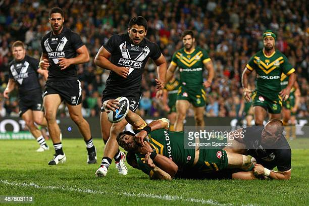 Greg Inglis of the Kangaroos is tackled short of the tryline during the ANZAC Test match between the Australian Kangaroos and the New Zealand Kiwis...