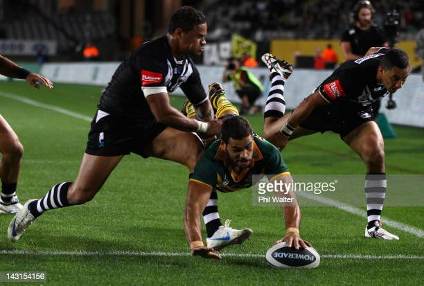 Greg Inglis of the Kangaroos scores a try in the corner during the ANZAC Test match between the New Zealand Kiwis and the Australian Kangaroos at...