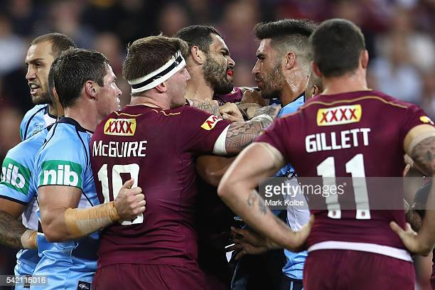 Greg Inglis of the Maroons and James Tamou of the Blues exchange heated words during game two of the State Of Origin series between the Queensland...