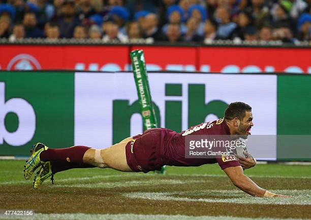 Greg Inglis of the Maroons celebrates as he scores a try during game two of the State of Origin series between the New South Wales Blues and the...