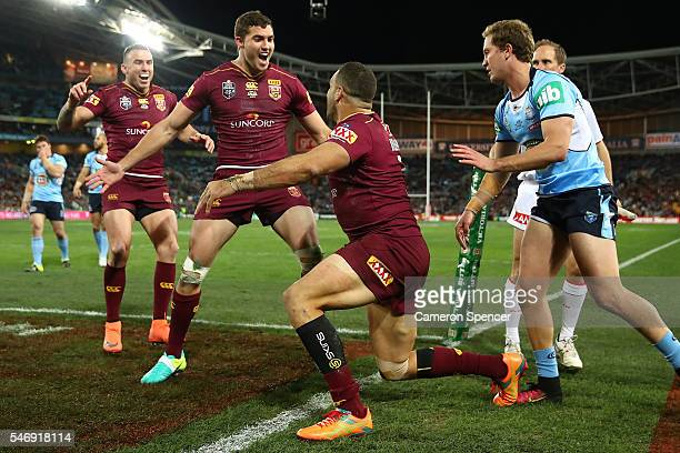 Greg Inglis of the Maroons celebrates scoring a try during game three of the State Of Origin series between the New South Wales Blues and the...