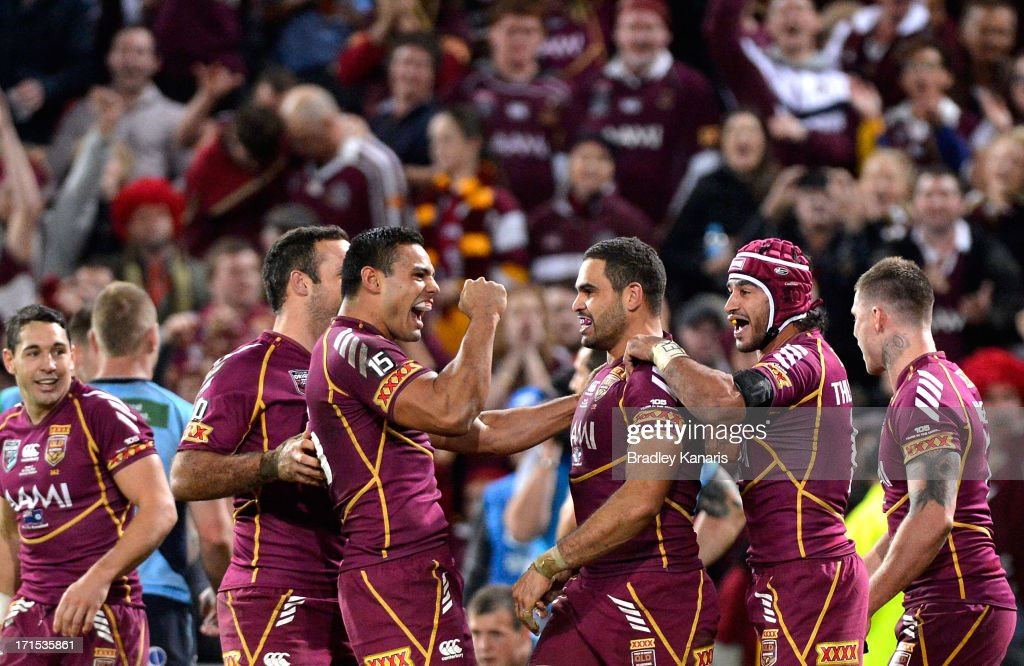 Greg Inglis of the Maroons celebrates with Ben Te'o and team mates during game two of the ARL State of Origin series between the Queensland Maroons and the New South Wales Blues at Suncorp Stadium on June 26, 2013 in Brisbane, Australia.
