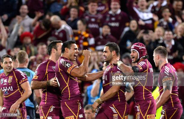 Greg Inglis of the Maroons celebrates with Ben Te'o and team mates during game two of the ARL State of Origin series between the Queensland Maroons...