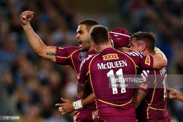 Greg Inglis of the Maroons celebrates with Johnathan Thurston after his try during game three of the ARL State of Origin series between the New South...