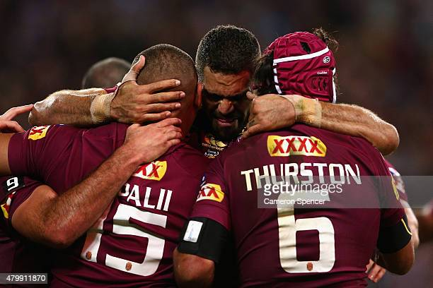 Greg Inglis of the Maroons congratulates Josh Papalii of the Maroons after scoring a try with team mate Johnathan Thurston during game three of the...