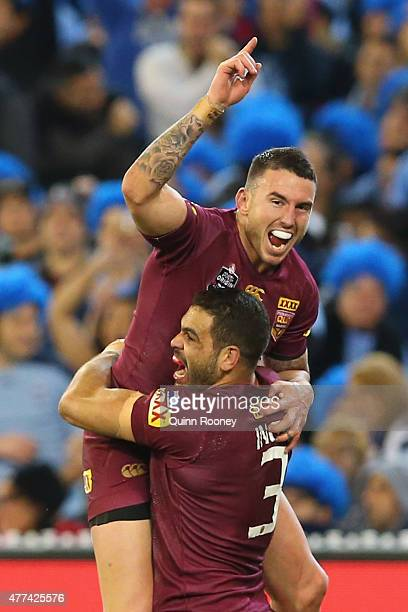 Greg Inglis of the Maroons is congratulated by Darius Boyd after scoring a try during game two of the State of Origin series between the New South...