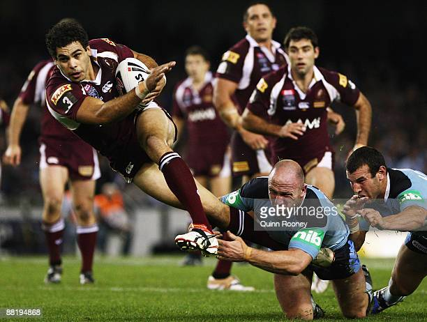 Greg Inglis of the Maroons is tackled during game one of the ARL State of Origin series between the Queensland Maroons and the New South Wales Blues...