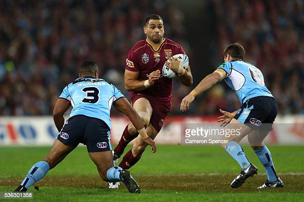 Greg Inglis of the Maroons is tackled during game one of the State Of Origin series between the New South Wales Blues and the Queensland Maroons at...