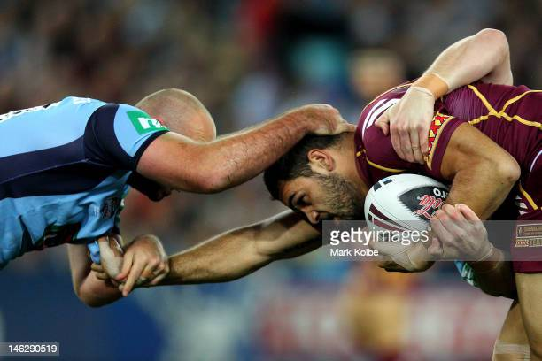 Greg Inglis of the Maroons is tackled during game two of the ARL State of Origin series between the New South Wales Blues and the Queensland Maroons...