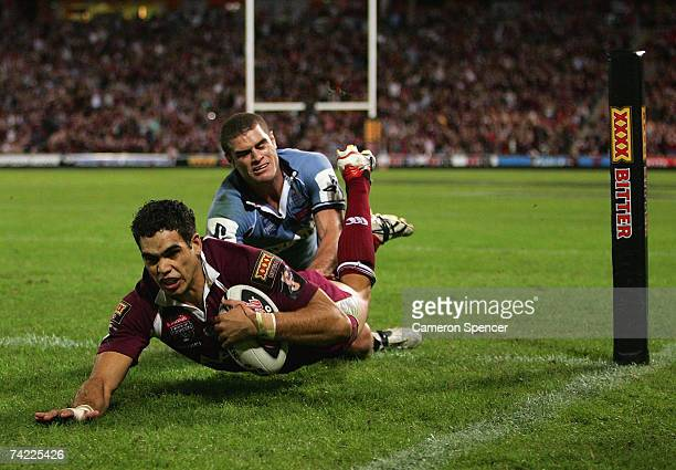 Greg Inglis of the Maroons scores a try during game one of the State of Origin series between the Queensland Maroons and the New South Wales Blues at...