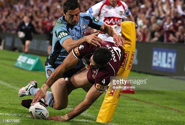 Greg Inglis of the Maroons scores a try during game three of the ARL State of Origin series between the Queensland Maroons and the New South Wales...