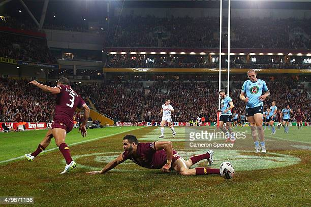 Greg Inglis of the Maroons scores a try during game three of the State of Origin series between the Queensland Maroons and the New South Wales Blues...