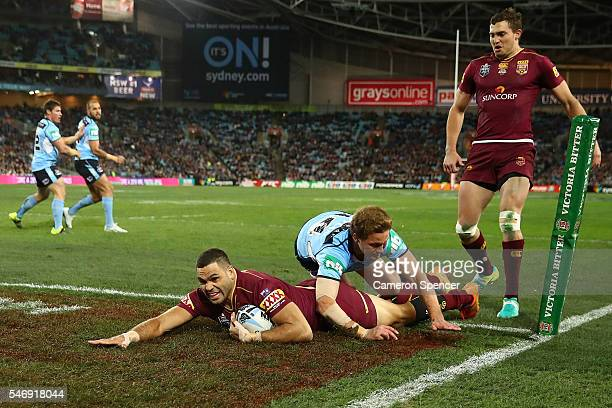 Greg Inglis of the Maroons scores a try during game three of the State Of Origin series between the New South Wales Blues and the Queensland Maroons...