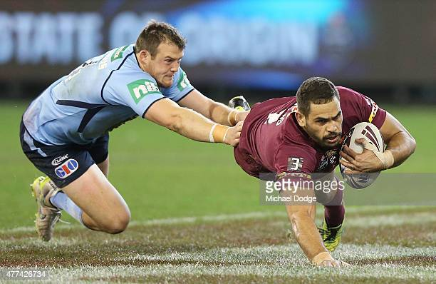 Greg Inglis of the Maroons scores a try past Josh Morris of the Blues that was not allowed after a replay during game two of the State of Origin...