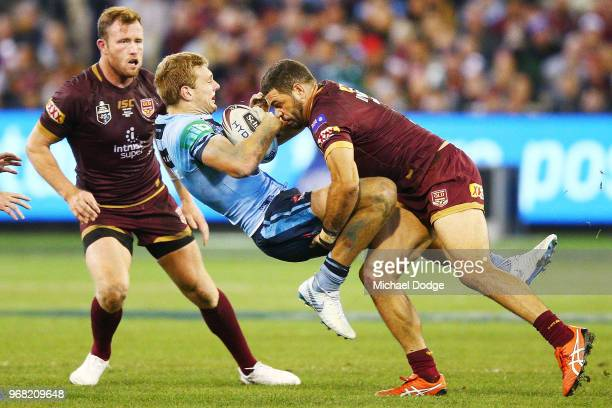 Greg Inglis of the Maroons tackles Tom Trbojevic of the Blues during game one of the State Of Origin series between the Queensland Maroons and the...