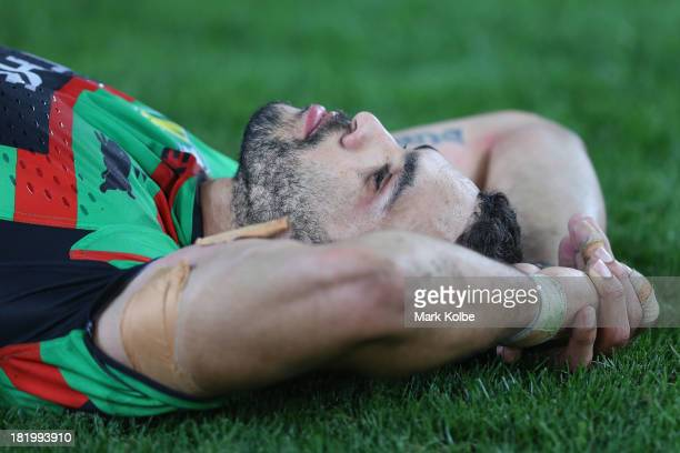 Greg Inglis of the Rabbioths lies dejected on the ground after defeat during the NRL Preliminary Final match between the South Sydney Rabbitohs and...