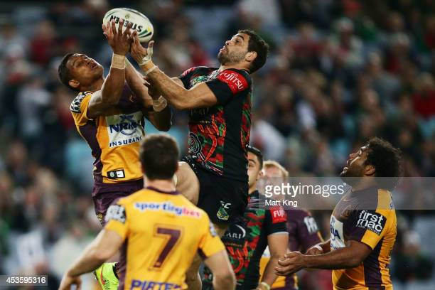 Greg Inglis of the Rabbitohs beats Ben Barba of the Broncos for a high ball before setting up the try to Luke Keary during the round 23 NRL match...