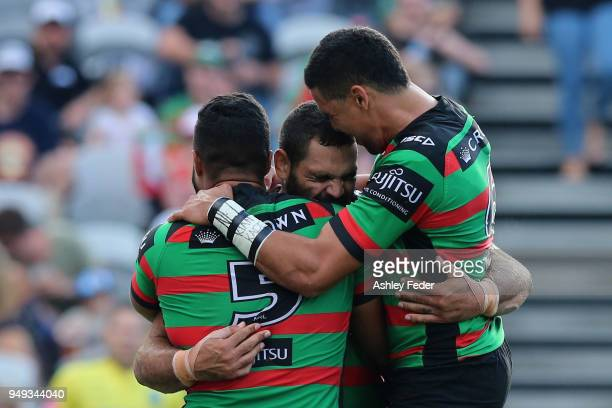 Greg Inglis of the Rabbitohs celebrates his try with team mates during the round seven NRL match between the South Sydney Rabbitohs and the Canberra...