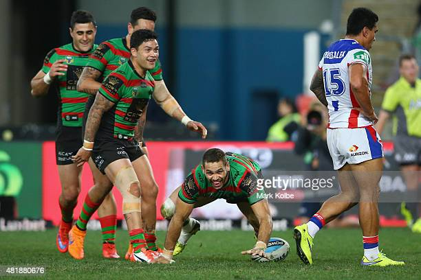 Greg Inglis of the Rabbitohs celebrates scoring his third try during the round 20 NRL match between the South Sydney Rabbitohs and the Newcastle...