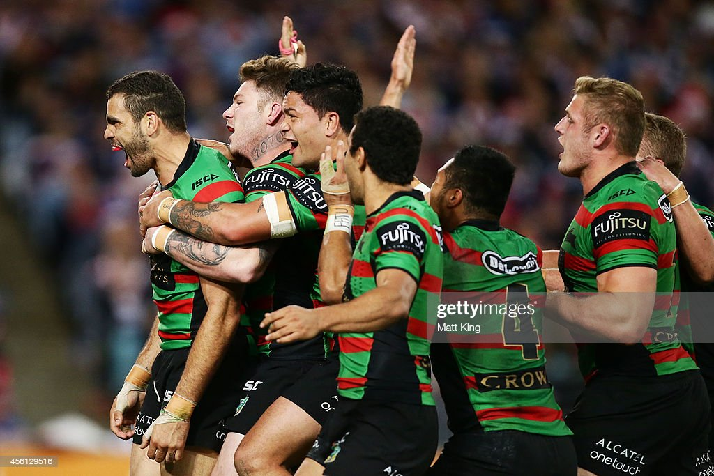 Greg Inglis (L) of the Rabbitohs celebrates team mates after scoring his second try during the First Preliminary Final match between the South Sydney Rabbitohs and the Sydney Roosters at ANZ Stadium on September 26, 2014 in Sydney, Australia.