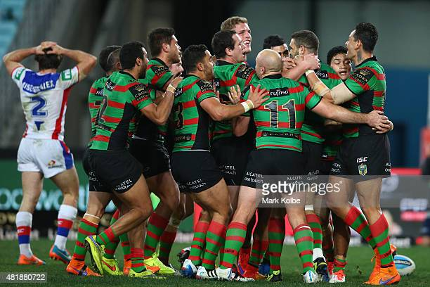 Greg Inglis of the Rabbitohs celebrates with his team mates after scoring a try during the round 20 NRL match between the South Sydney Rabbitohs and...