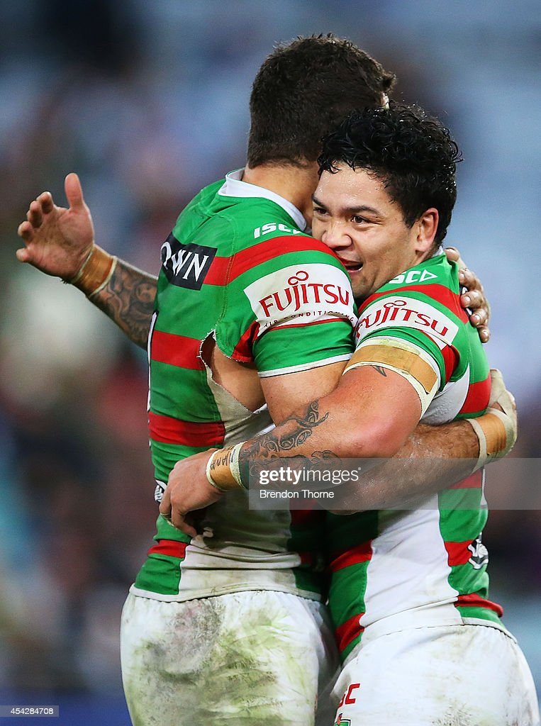 Greg Inglis of the Rabbitohs celebrates with team mate Issac Luke at full time after victory over the Bulldogs during the round 25 NRL match between the Canterbury Bulldogs and the South Sydney Rabbitohs at ANZ Stadium on August 28, 2014 in Sydney, Australia.