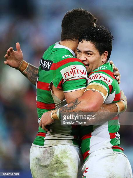 Greg Inglis of the Rabbitohs celebrates with team mate Issac Luke at full time after victory over the Bulldogs during the round 25 NRL match between...