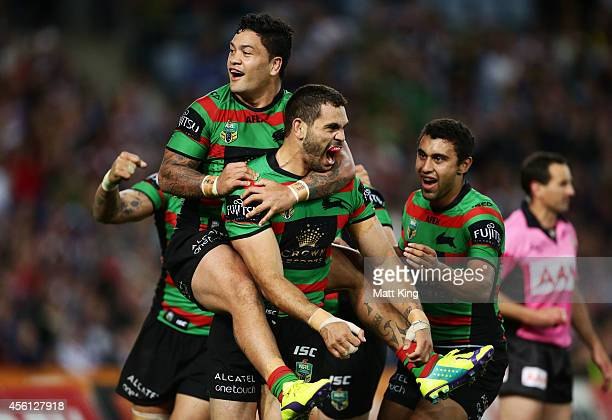 Greg Inglis of the Rabbitohs celebrates with team mates after scoring his first try during the First Preliminary Final match between the South Sydney...