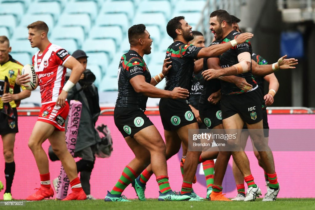 Greg Inglis of the Rabbitohs celebrates with team mates after scoring a try during the round 10 NRL match between the South Sydney Rabbitohs and the St George Illawarra Dragons at ANZ Stadium on May 13, 2018 in Sydney, Australia.