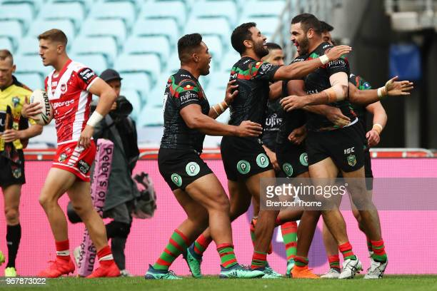 Greg Inglis of the Rabbitohs celebrates with team mates after scoring a try during the round 10 NRL match between the South Sydney Rabbitohs and the...