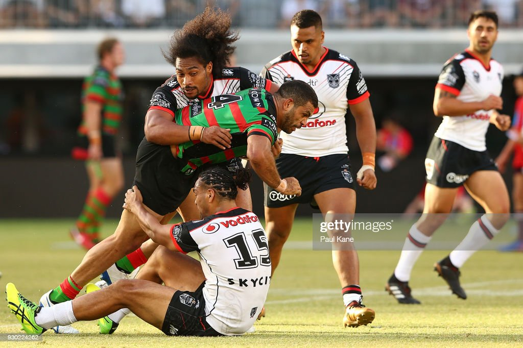 Greg Inglis of the Rabbitohs gets tackled by Bunty Afoa and Leivaha Pulu of the Warriors during the round one NRL match between the South Sydney Rabbitohs and the New Zealand Warriors at Optus Stadium on March 10, 2018 in Perth, Australia.