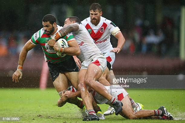 Greg Inglis of the Rabbitohs is tackled by Tyson Frizell of the Dragons during the round three NRL match between the St George Dragons and the South...