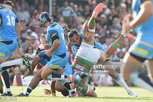 Greg Inglis of the Rabbitohs is tackled by Zeb Taia of the Titans during the NRL trial match between the Gold Coast Titans and the South Sydney...