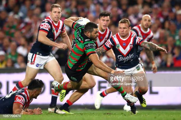 Greg Inglis of the Rabbitohs is tackled during the NRL Preliminary Final match between the Sydney Roosters and the South Sydney Rabbitohs at Allianz...