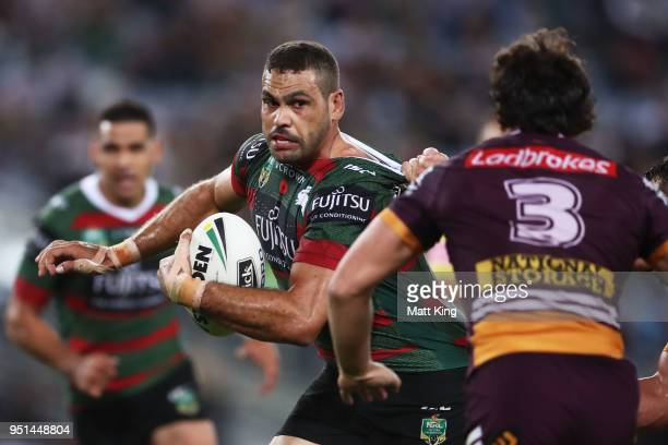 Greg Inglis of the Rabbitohs is tackled during the NRL round eight match between the South Sydney Rabbitohs and the Brisbane Broncos at ANZ Stadium...
