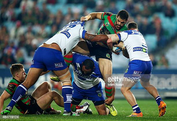 Greg Inglis of the Rabbitohs is tackled during the round 24 NRL match between the South Sydney Rabbitohs and the Canterbury Bulldogs at ANZ Stadium...