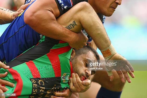 Greg Inglis of the Rabbitohs is tackled during the round four NRL match between the South Sydney Rabbitohs and the Canterbury Bulldogs at ANZ Stadium...