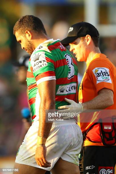 Greg Inglis of the Rabbitohs leaves the field with a trainer during the round two NRL match between the Penrith Panthers and the South Sydney...