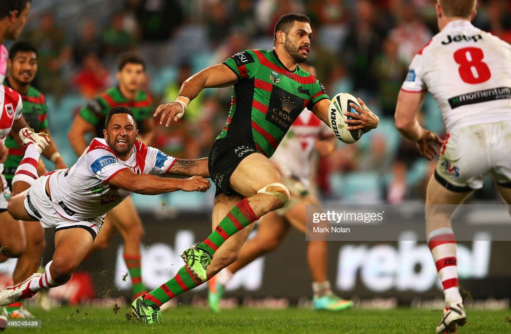 Greg Inglis of the Rabbitohs makes a line break as Benji Marshall of the Dragons falls off the tackle during the round 12 NRL match between the South Sydney Rabbitohs and the St George Illawarra Dragons at ANZ Stadium on June 2, 2014 in Sydney, Australia.