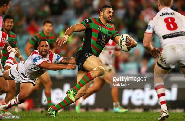 Greg Inglis of the Rabbitohs makes a line break as Benji Marshall of the Dragons falls off the tackle during the round 12 NRL match between the South...
