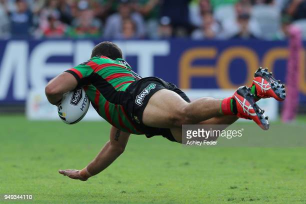 Greg Inglis of the Rabbitohs scores a try during the round seven NRL match between the South Sydney Rabbitohs and the Canberra Raiders at Central...