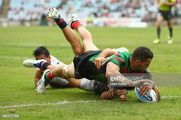 Greg Inglis of the Rabbitohs scores a try during the round three NRL match between the South Sydney Rabbitohs and the Wests Tigers at ANZ Stadium on...