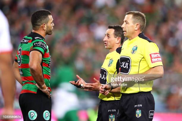 Greg Inglis of the Rabbitohs speaks to referees Gerard Sutton and Ben Cummins during the NRL Semi Final match between the South Sydney Rabbitohs and...