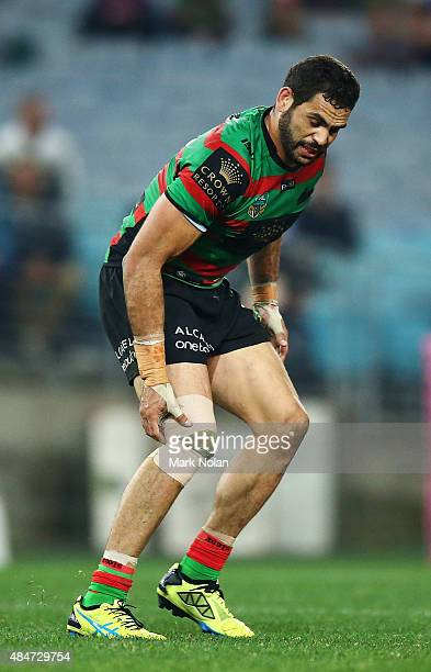Greg Inglis of the Rabbitohs suffers from a knee injury during the round 24 NRL match between the South Sydney Rabbitohs and the Canterbury Bulldogs...