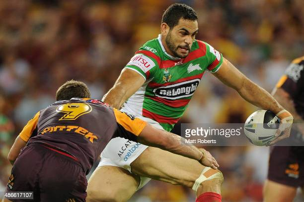 Greg Inglis of the Rabbitohs takes on the defence during the round 8 NRL match between the Brisbane Broncos and the South Sydney Rabbitohs at Suncorp...