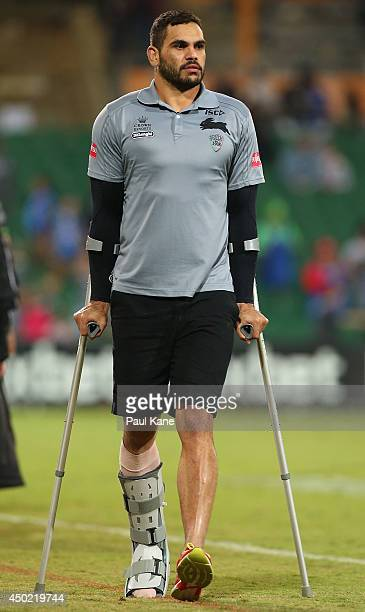 Greg Inglis of the Rabbitohs walks to the room on crutches after the round 13 NRL match between the South Sydney Rabbitohs and the New Zealand...