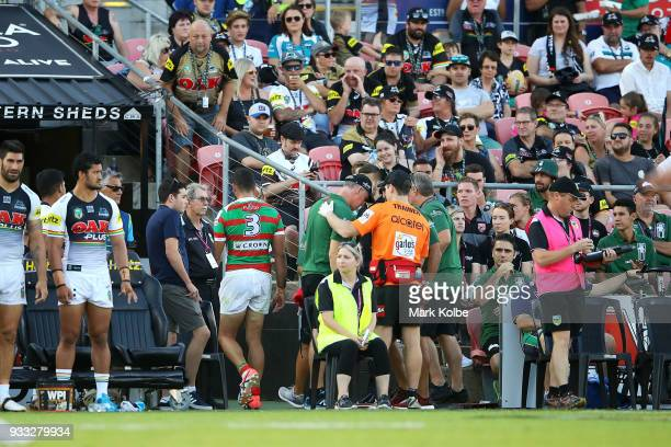 Greg Inglis of the Rabbitohs walks up the tunnel as he leaves the field with a trainer during the round two NRL match between the Penrith Panthers...