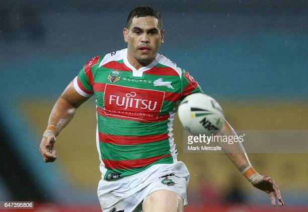 Greg Inglis of the Rabbitohs watches the ball before scoring a try during the round one NRL match between the South Sydney Rabbitohs and the Wests...