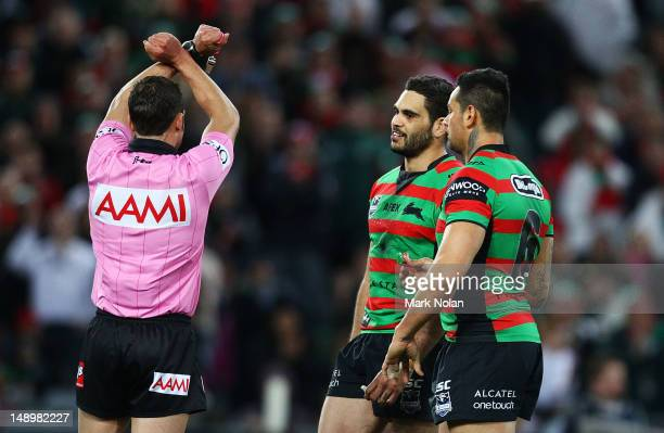 Greg Inglis of the Rabittohs is put on report for his tackle on Dean Young of the Dragons during the round 20 NRL match between the South Sydney...